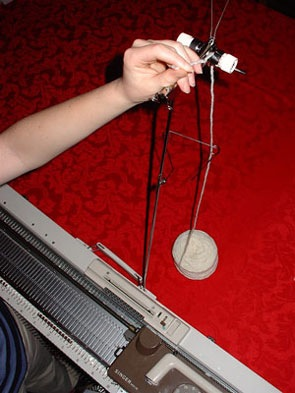 how to thread a knitting machine step 4 yarn through tension dial