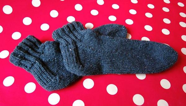 crop ankle rolled top hand knit sock in navy blue aarlan royal tweed wool yarn on pink polka dots